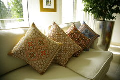 Tapestry cushions. Four beautiful tapestry cushions on a cream sofa Royalty Free Stock Photo