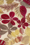 Tapestry fabric. Portrait view of a floral tapestry fabric textured textile with leaves and branches Stock Images
