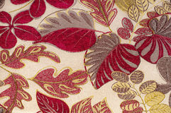 Tapestry fabric. Landscape view of a tapestry fabric textured with leaves and branches Stock Photos