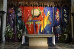 The High Altar Tapestry by John Piper in Chichester Cathedral. The tapestry by John Piper behind the altar in Chichester Cathedral Royalty Free Stock Photography