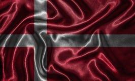 Tapet av den Danmark flaggan och den vinkande flaggan vid tyg Royaltyfri Fotografi