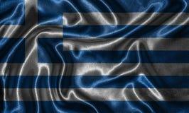 Tapet av den Grekland flaggan och den vinkande flaggan vid tyg Arkivbild