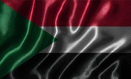 Tapet av den Sudan flaggan och den vinkande flaggan vid tyg Royaltyfri Foto