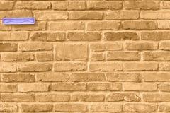 Tapete einer antiken Sepiabacksteinmauer stockfoto