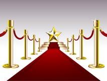 Tapete vermelho com estrela dourada Fotografia de Stock Royalty Free