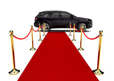 Tapete vermelho e SUV luxuoso Foto de Stock Royalty Free