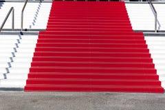 Tapete vermelho em Cannes, França Stairs da fama Fotos de Stock