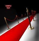 Tapete vermelho isolado no preto Fotos de Stock Royalty Free