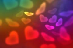 Tapeten till valentins dag med regnbågen färgar hjärtor royaltyfri illustrationer