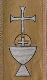 Tapicería cristiana de los símbolos de la comunión santa Fotografía de archivo