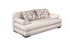 Tapicerowanie kanapa ustawiająca z zmienia deseniowe poduszki odizolowywać na whit Zdjęcie Stock