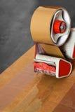 Taping box tape dispenser Royalty Free Stock Photo