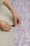 Taping fabric to table. Stock Photography