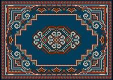 Tapis bariolé luxueux aux nuances bleues et rouges avec le modèle sur un champ bleu au centre image stock