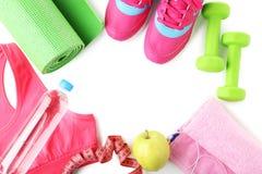Tapis de forme physique, chaussures, haltères Image libre de droits