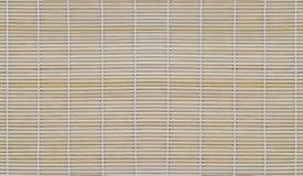 Tapis en bambou sec pour la nourriture de petit pain, fond en bambou de texture Image libre de droits