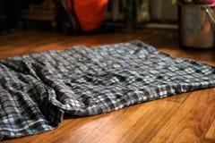 Tapis froissé par plaid de plancher Image libre de droits