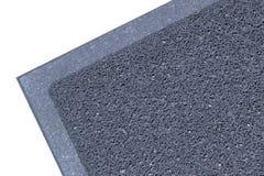 tapis gris de vinyle pour la poussière de piège d'isolement Image stock