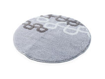 Tapis gris rond d'isolement sur le fond blanc Photo stock