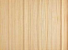 Tapis jaune de sushi fait à partir du bambou naturel Images stock