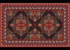 Tapis oriental de vintage de luxe avec les nuances rouges, bleues, grises et brunes sur le fond noir illustration libre de droits