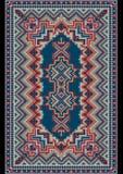 Tapis oriental luxueux de vintage aux nuances rouges et bleues Images libres de droits