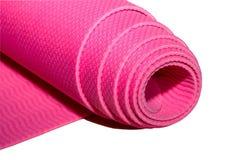 Tapis rose roulé de forme physique ou de yoga Photo stock