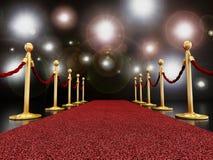 Tapis rouge la nuit avec des lampes-torches Image stock