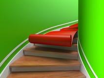 Tapis rouge sur les escaliers spiralés Photographie stock