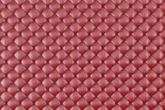 Tapisserie d'ameublement en cuir Sofa Background Sofa de luxe rouge de décoration Texture en cuir rouge élégante avec des boutons Photo stock
