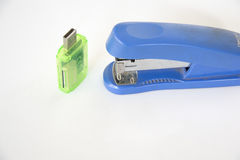Tapler and card reader. Blue stapler and green card reader in detail with creativity Stock Images
