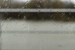 tappar glass regn Arkivbild
