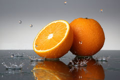 tappar orange vatten Royaltyfri Foto