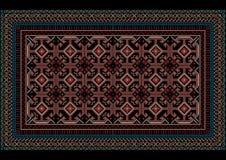 Tappeto orientale chiazzato con il modello originale su un fondo nero Fotografia Stock