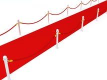 Tappeto rosso con le barriere della corda su priorità bassa bianca Fotografia Stock