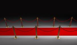 Tappeto rosso isolato sul nero Fotografia Stock Libera da Diritti