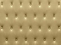 Tappezzeria di cuoio dorata lussuosa del sedile immagini stock