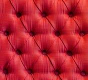 Tappezzeria rossa in profondità attenuata del tessuto Fotografia Stock