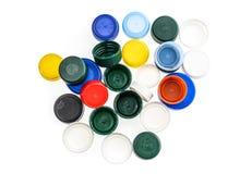 Tappi di bottiglia di plastica nei colori differenti Immagini Stock Libere da Diritti