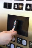 Tapping key tag on elevator Royalty Free Stock Image