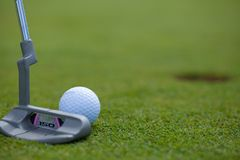 Tapping In. Photo of a ball just inches from the hole, tapping in royalty free stock photos