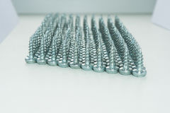 Tapping screws. Orderly arranged in rows hat down Royalty Free Stock Photo