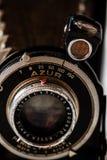 Tappning Azur Folding Camera på marmorbakgrund royaltyfri bild