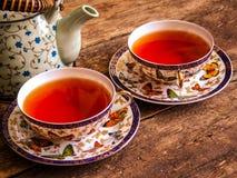 Tappning för bräde för grönt te för svart te för tekanna gammal arkivfoto