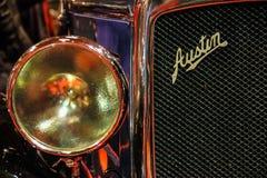 tappning för sepia för bilbil retro Austin emblem Elementskyddsgaller arkivfoton