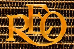 tappning för sepia för bilbil retro REO Motor Car Company emblem Elementskyddsgaller arkivfoto