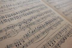 Tappning för musikark - gamla musikanmärkningar Arkivbilder