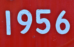 Tappning hand-målade årsvitnummer på rött Royaltyfri Foto