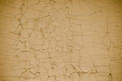 Tappning knäckte flagig gul målarfärgbakgrund Abstrakt gul skalande målarfärg som är abstrakt Modell av textur för vägg för Ñ-ku arkivfoto