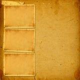 Tappningalbum med pappersramar för foto royaltyfri bild